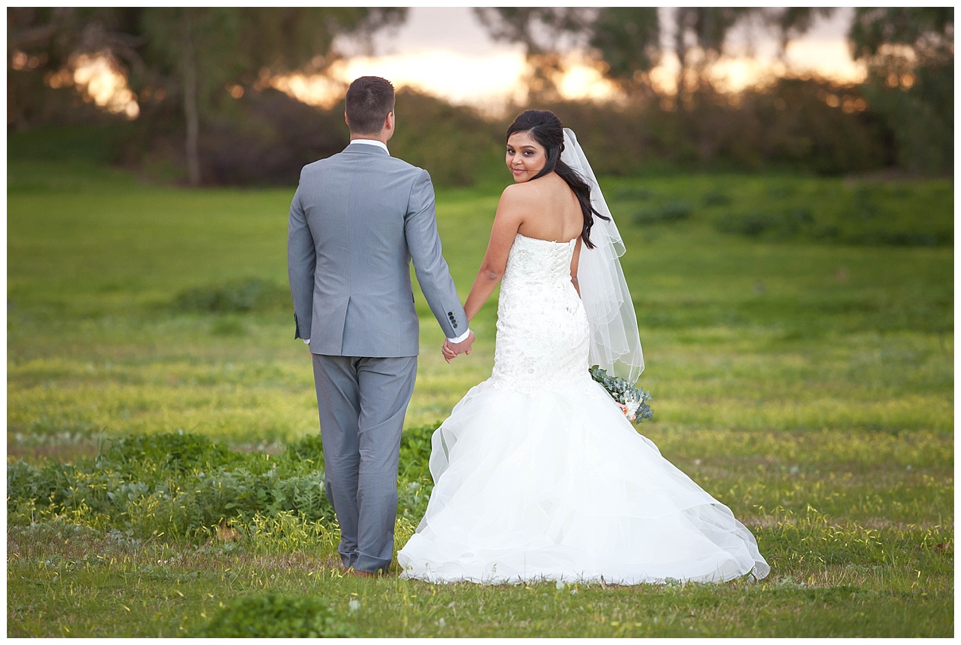 Bride and groom with epic sky at Sandalford Winery in The Swan Valley