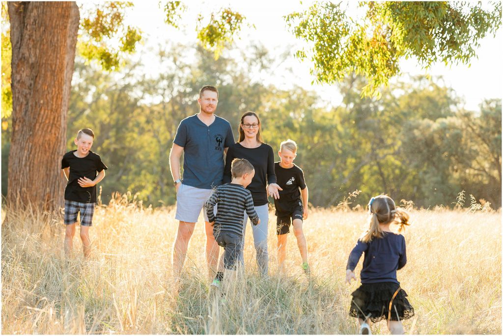 Perth family photographer WhiteJasmin Photography photographs family in a field in summer in Perth.